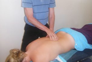 Woman receiving a treatment from a Chiropractor in Norwest