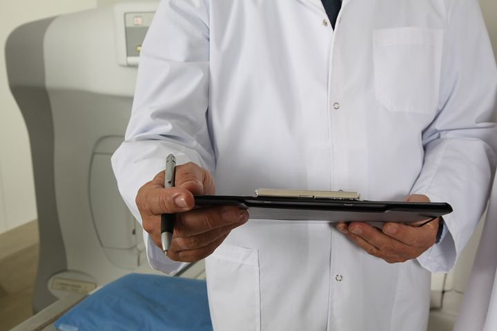 house call doctor in Brisbane writing a medical record