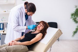 best dermatologist in Melbourne checking a female patient's skin