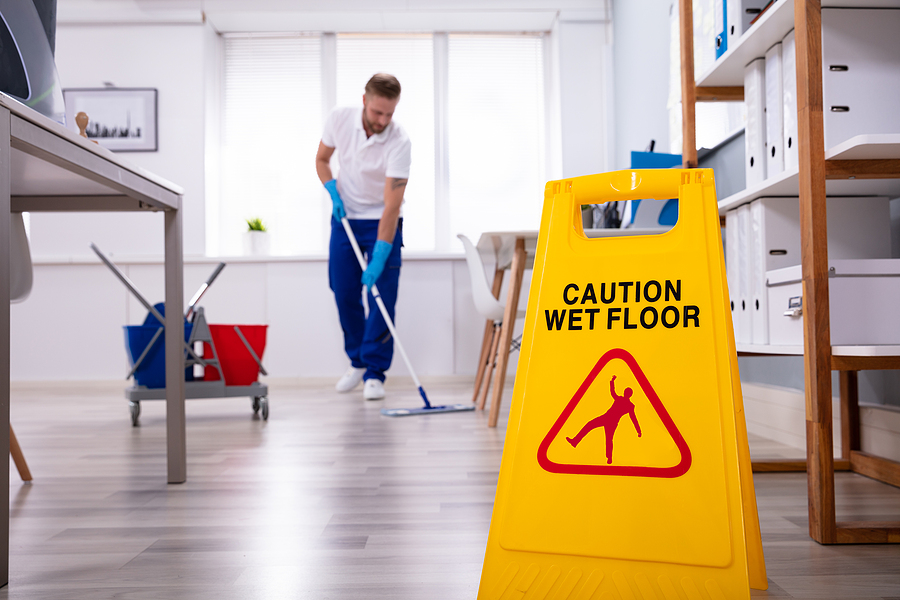 Professional office cleaner in Sydney mopping the floor