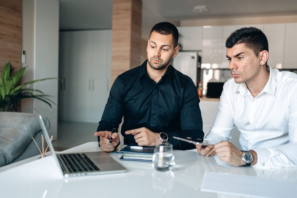 Two programmers working in a blockchain development company in Australia